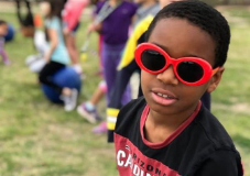Student in red sunglasses at recess