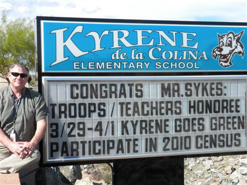 Mr.Sykes next to Colina Sign