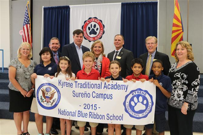 KTA Students Staff holding blue ribbon banner