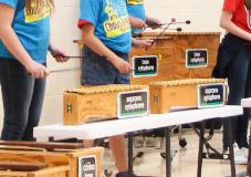 students playing the marimbas