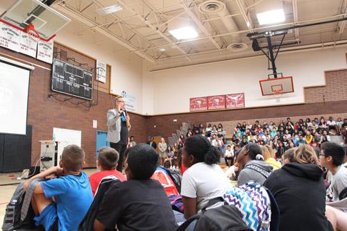 Collin Kartchner speaking to students at Centennial Middle School