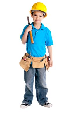image of boy with hard hat, tool belt and pipe