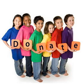 Children holding blocks that spell out Donate